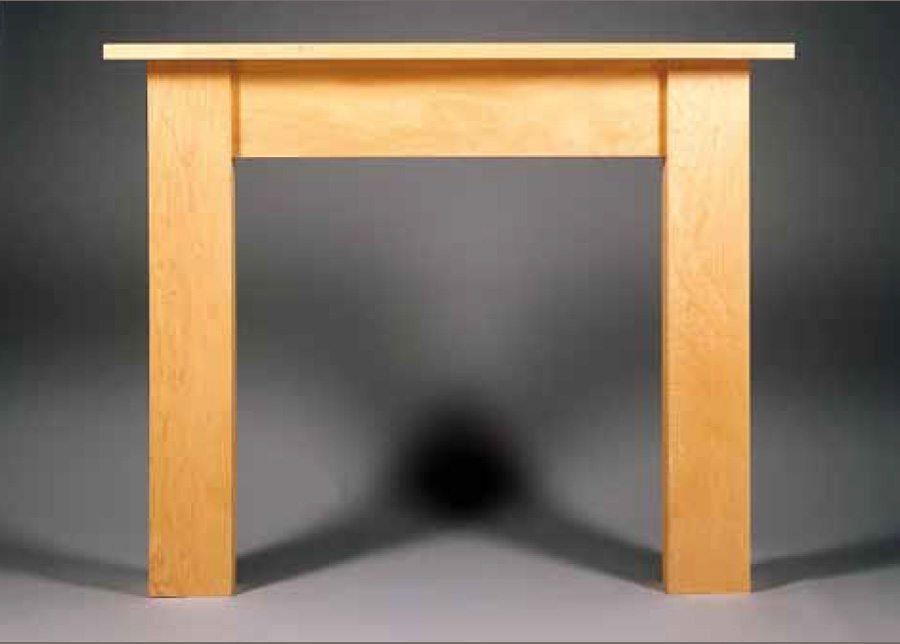 Raeburn contemporary wood fireplace surround brighton for Contemporary wood fireplace